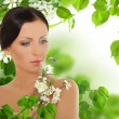 Stock Photo: Beautiful young womwith spring blossom