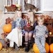 Stock Photo: Autumn kids - little boy and girls with pumpkin and leaves