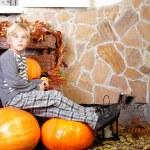Boy with autumn pumpkin — Stock Photo #31968821
