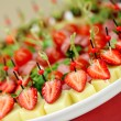 Appetizers, gourmet food - canape with cheese and strawberries, — Stock Photo