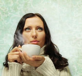 Woman in warm scarf with hot drink — Stock Photo