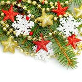 Christmas shiny stars and snowflake on white background — Stock Photo