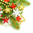 Christmas fir tree twig on decorations background — Stock Photo