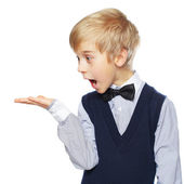 Surprised boy showing something and looking at hand — Stock Photo