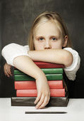 Tired child with books — Stock Photo