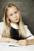 Pupil - small cute girl in school uniform — Stock Photo