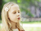 Wishes - little girl outdoors — Stock Photo