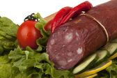 Sausage with vegetables on board — Stock Photo