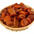 Stock Photo: Basket with dried apricots