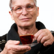 Handsome elderly man drinking coffee — Stock Photo #10175128