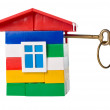 Toy house with golden key — Stock Photo #10370459