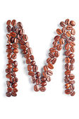 Letter M from coffee beans — Stock Photo