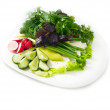 Plate of salad include lettuce, basil, parsley, cucumber, feta cheese, radish, on the white background — Stock Photo #49188197