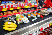 Conveyor belt at the market, checkout — Stock Photo