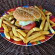 Stock Photo: Beef cheeseburger and french fries