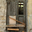Stock Photo: Boarded up old window shutter