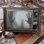 Ghost appears on flickering tv set — ストック写真