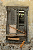 Boarded up old window shutter — Stock Photo