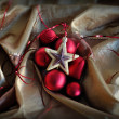 Red baubles and golden star christmas ornaments - Stockfoto