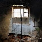 Sunlight through broken window — Stock Photo #16799685
