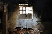 Sunlight through broken window — Stock Photo