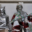 Statues wrapped in plastic -  