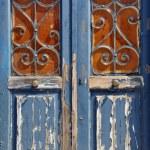 Wooden door vintage metal frame — Stock Photo