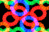 Light dots and colorful circles — Stock Photo
