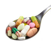 Spoon of pills — Stock Photo