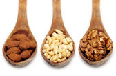 Spoons of nuts — Stock Photo