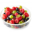 Bowl of fresh ripe berries on white background — Stock Photo #28013439