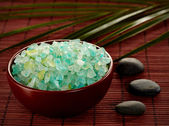 Bowl of green bath salts — Stock Photo