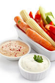 Fresh vegetables and dips — Stock Photo
