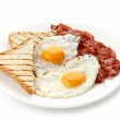 Breakfast with fried eggs, bacon and toasts — Stock Photo #38107541