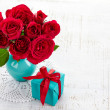 Roses and gift box — Stock Photo #38911307