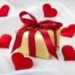 Gift box and hearts — Stock Photo #40770485