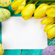 Easter eggs, tulips and card — Stock Photo