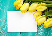 Tulips and blank card — Stock Photo