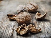 Nuts on rustic wooden table — Stock Photo