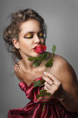 Woman with rose — Stock fotografie