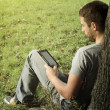 Young man reading e-book — Stock Photo #33363837