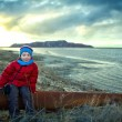 Stock Photo: Child on shore of lake near mines. humimpact on