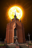 Sunset over the church — Stock Photo