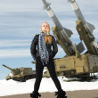 Girl and ballistic missile — Stock Photo