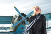 Girl and plane winter — Stock Photo