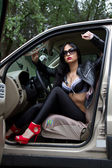 Girl in the car — Stockfoto