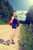 Pin up hitchhiking — Stock Photo