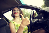 Girl behind the wheel — Stock Photo