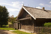 Wooden house in the village — Stock Photo