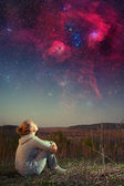Girl and a starry sky. Elements of this image furnished by NASA  — Stock Photo